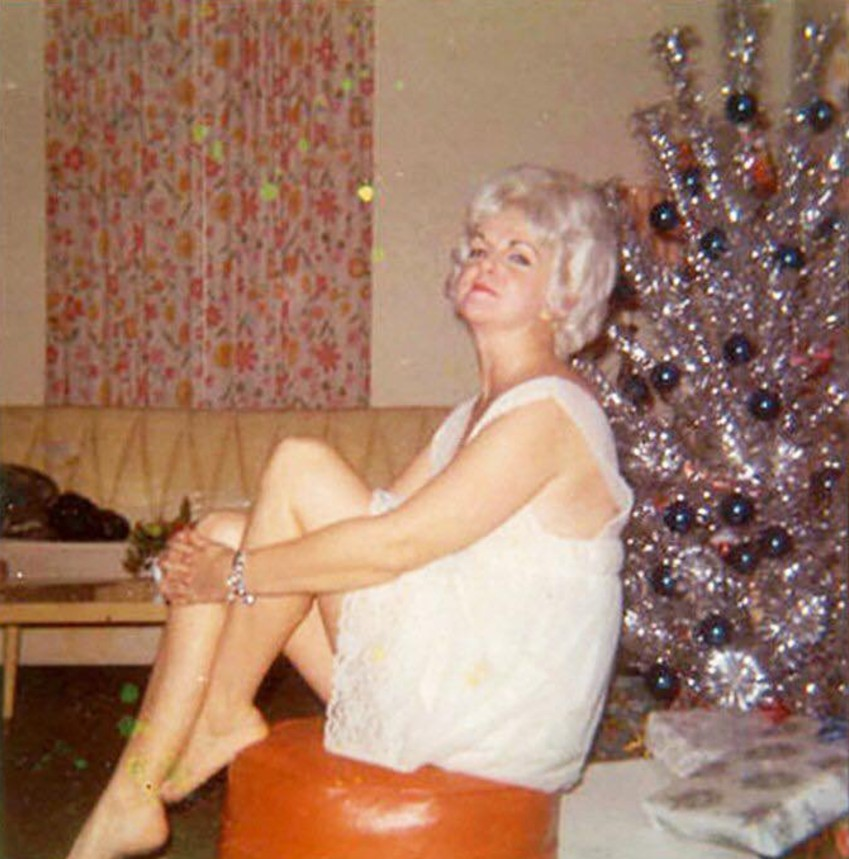 vintage women in front of mid-century Christmas trees