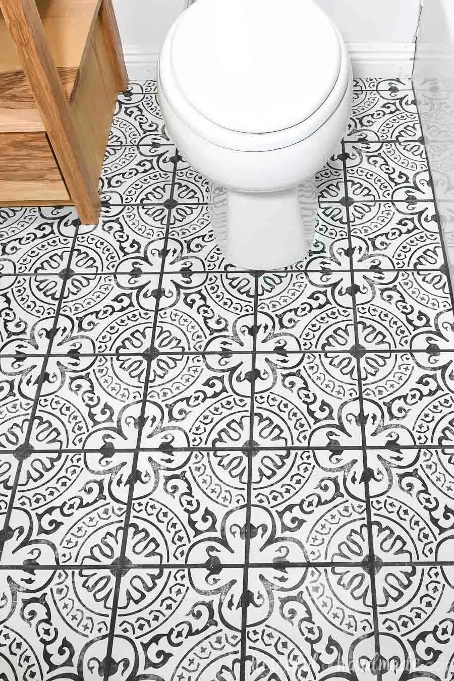 laying floor tiles in a small bathroom