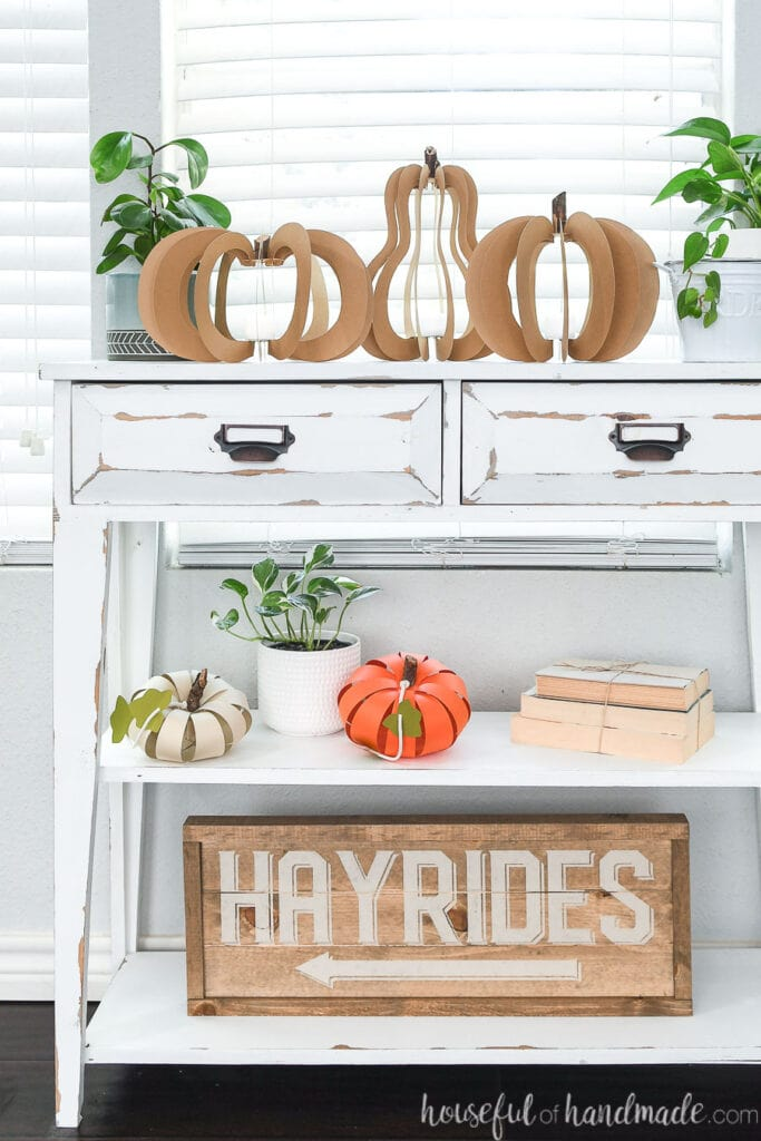 Fall vignette with 3D paper pumpkins and wood Hayrides sign.
