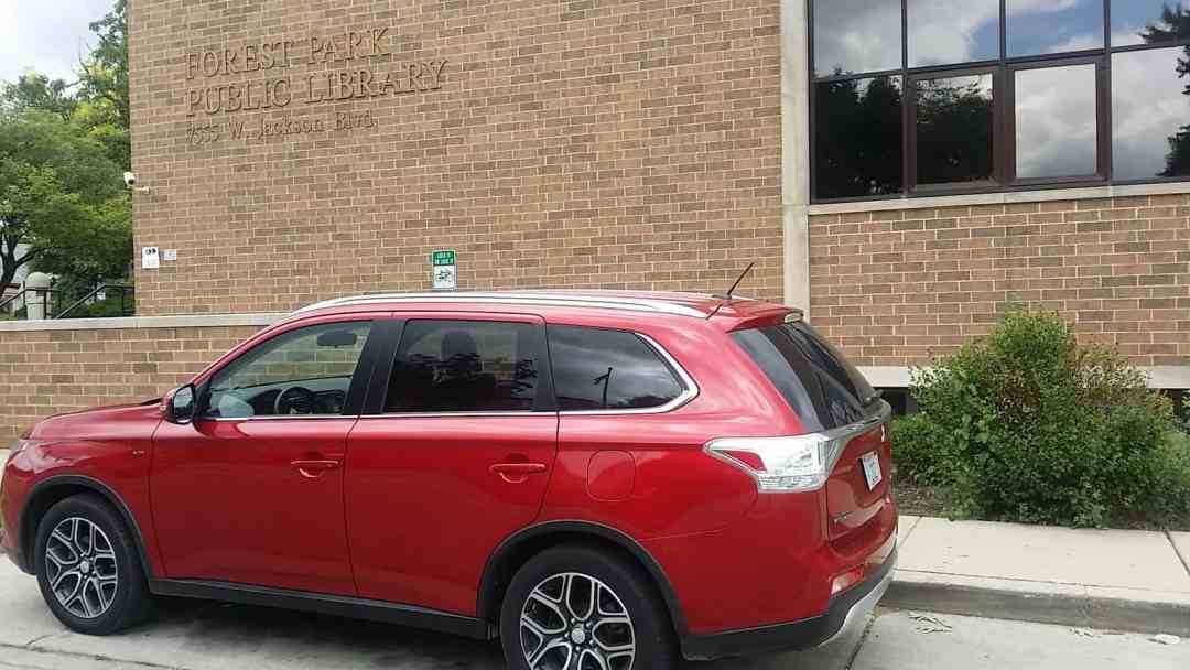 Mitsubishi Outlander outside of Forest Park Public Library