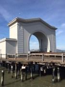 Fisherman's Wharf with Alcatraz through the arch.