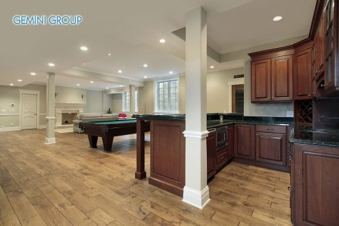Basement in new construction home with bar and fireplace