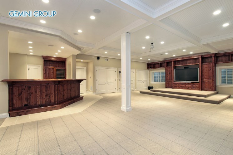 Basement in luxury home with step up TV area