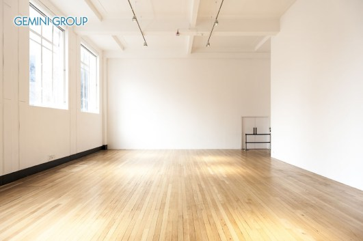Empty room with white walls and wooden parquet floor