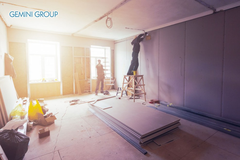 Workers are installing plasterboard (drywall) for gypsum walls in apartment is under construction, remodeling, renovation, extension, restoration and reconstruction