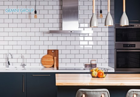 Modern interior. Spacious kitchen with white brick tile wall.