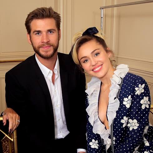 "Liam Hemsworth Is ""Living A Completely Different Life"" One Year After His Split From Miley Cyrus"