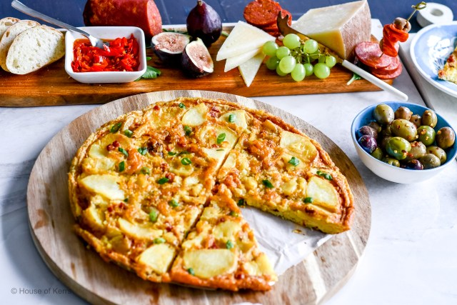 TortillaEspanola.SpanishOmelette on a food board served as a tapa