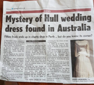 A colour photo of a newspaper article titled Mystery of Hull wedding dress found in Australia. The article talks about a fifties frock that ended up in a charity shop in Perth, but do you know its owner?