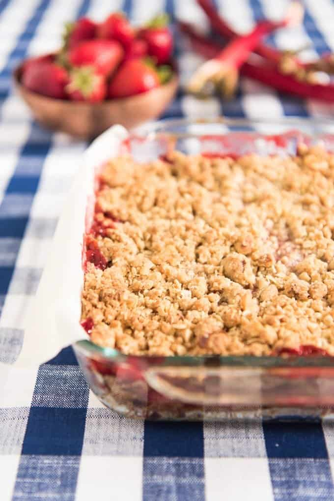 The sweet tart combo of strawberries and rhubarb with a buttery streusel crust and topping make these strawberry rhubarb crumb bars so, so, so delicious.