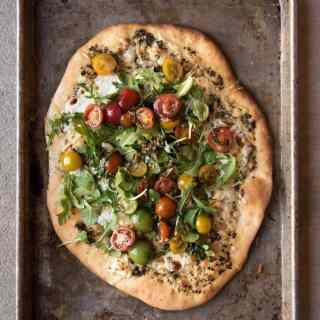 Pizza night is ON with this homemade four cheese pizza with tomato basil arugula salad! It's super easy to make and tastes ridiculously amazing.