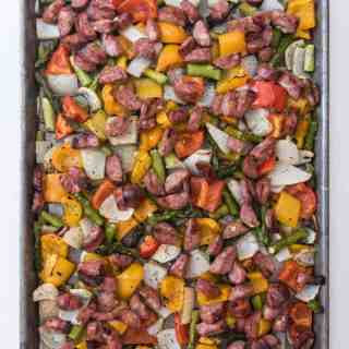 This gluten-free, low-carb and Whole 30 compliant dish is a perfect weeknight meal when you don't want to stand over the stove cooking dinner. One Pan Roasted Peppers, Onions, & Sausages is a healthy and versatile, and your whole family will love it!