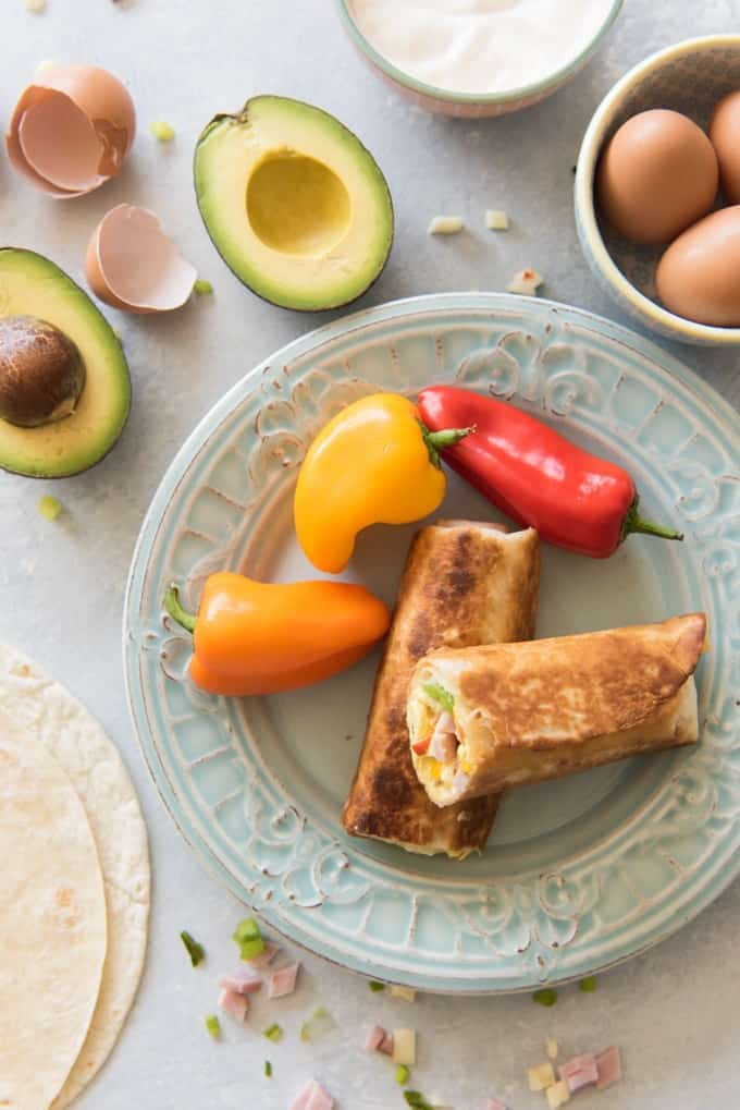 Easy, kid-friendly, super convenient and healthy breakfast burritos are the perfect way to start off your day. Plus, they freeze well and heat up in minutes so you can always have them on hand if you are running out the door! Sorry Pop-Tarts, but these best breakfast burritos are the boss.