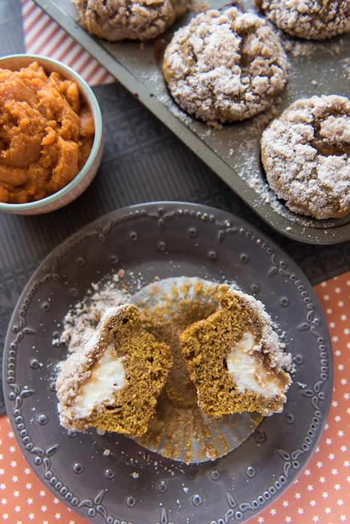 These Pumpkin Streusel Muffins with Cream Cheese Filling are sugar and spice and everything nice and then some. They are soft and rich and filled with a delightful cream cheese center - perfect for a Fall morning!
