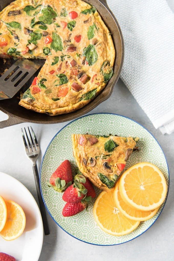 A savory, easy, ultimate breakfast frittata makes a wonderful breakfast, brunch or even lunch, especially when it is loaded with protein and veggies like red peppers, mushrooms, spinach, onions, and sausage. It's light and fluffy and comes together quickly. Plus, it's Whole30 compliant!