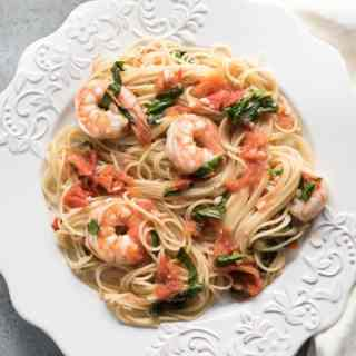 A classic combination of seafood and pasta, Angel Hair Pasta with Shrimp, Tomatoes and Fresh Basil makes for a simple, but elegant dinner with incredible flavors! It's an easy-fancy meal that is just as perfect to impress somebody special as it is to satisfy a hungry family on a weeknight when you need to get dinner on the table in under 30 minutes.