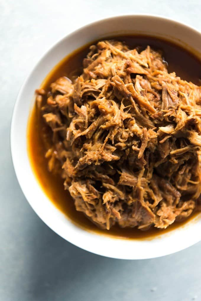 Cafe Rio Sweet Pork is super flavorful and easy to make at home. It's perfect for eating out at home and recreating our favorite pork salads, burritos and tacos since we don't live anywhere near a Cafe Rio!