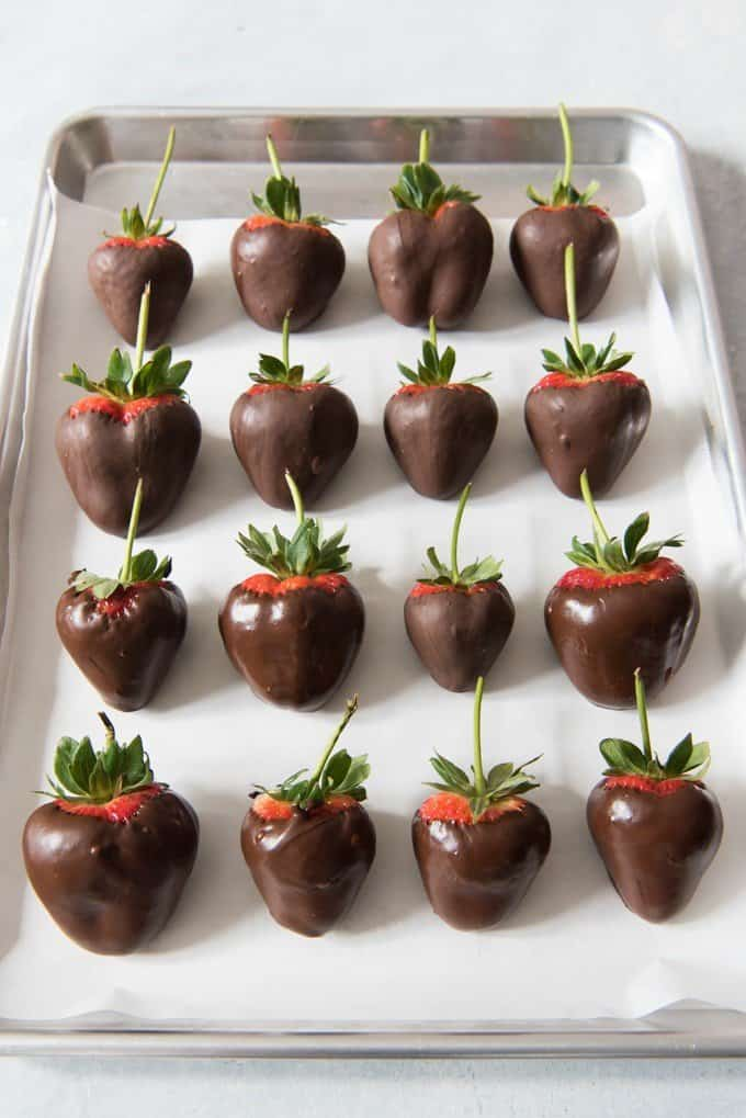 Chocolate covered strawberries are perfect for giving as gifts, using on top of cakes of cupcakes for a stunning presentation, or just eating out of hand for a special treat! Learn how to easily temper dark, milk or white chocolate for chocolate covered strawberries using the seeding method for tempering.