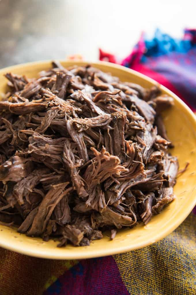 Slow Cooker Mexican Shredded beef is incredibly tender and delicious. It's super simple and easy to make and perfect for nachos, tacos, salads, burritos, chimichangas, chilaquiles, and more!