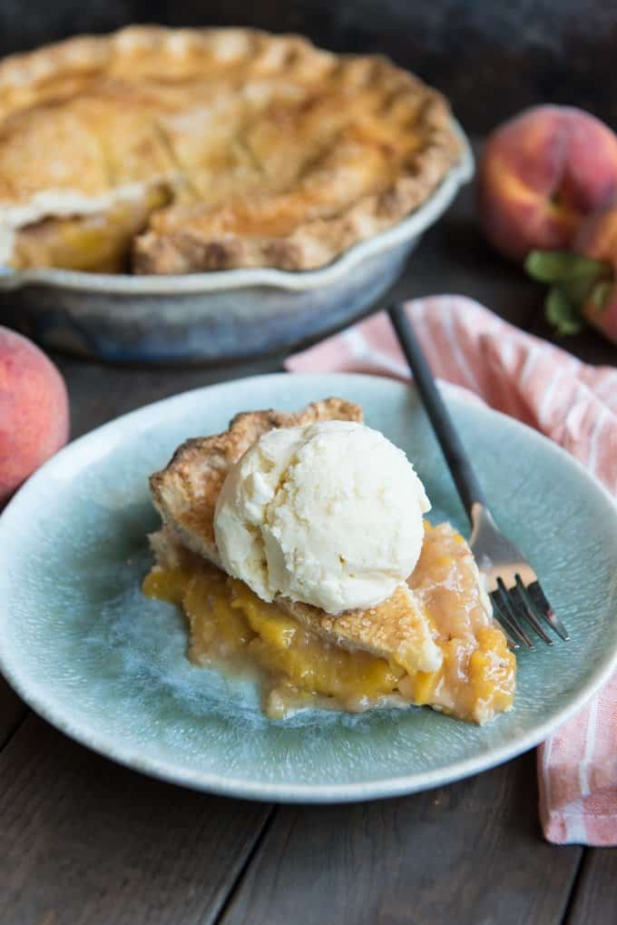 This classic, Southern Peach Pie is absolute dessert perfection! Filled with summer's juiciest, sweetest fresh peaches and made with a flaky, buttery double-crust dusted with sanding sugar, it's as beautiful a pie as it is delicious and wonderful served à la mode with a big scoop of vanilla ice cream!