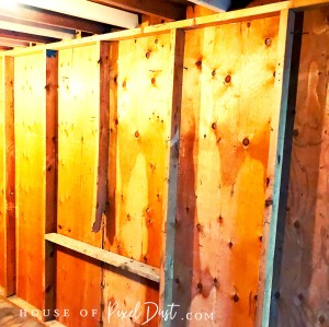 before raw wall studs old toolshed art studio renovation