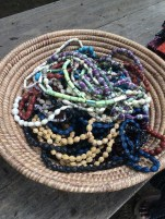 Elinora and her friends make these bracelets and necklaces out of seeds