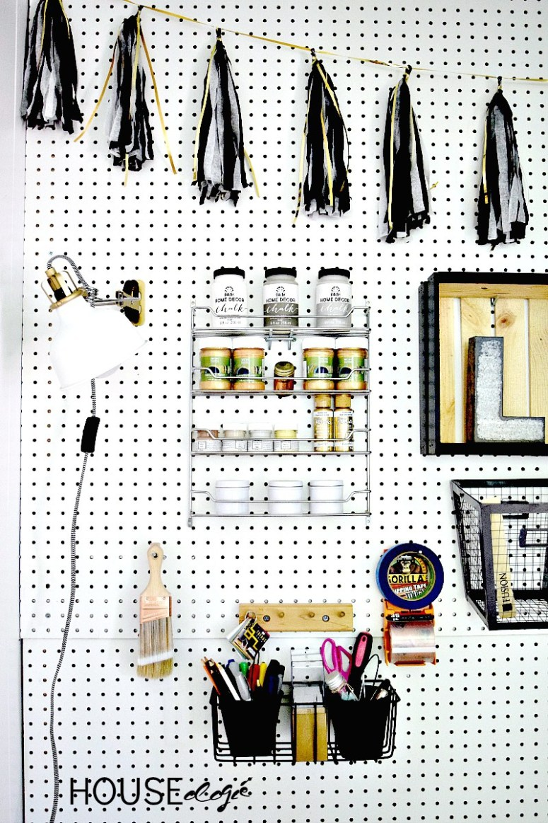 This blogger covered an entire wall with pegboard for craft storage! Cheap and stylish!!