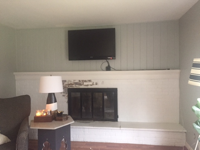 Peeling Paint on Fireplace, easily fixed!