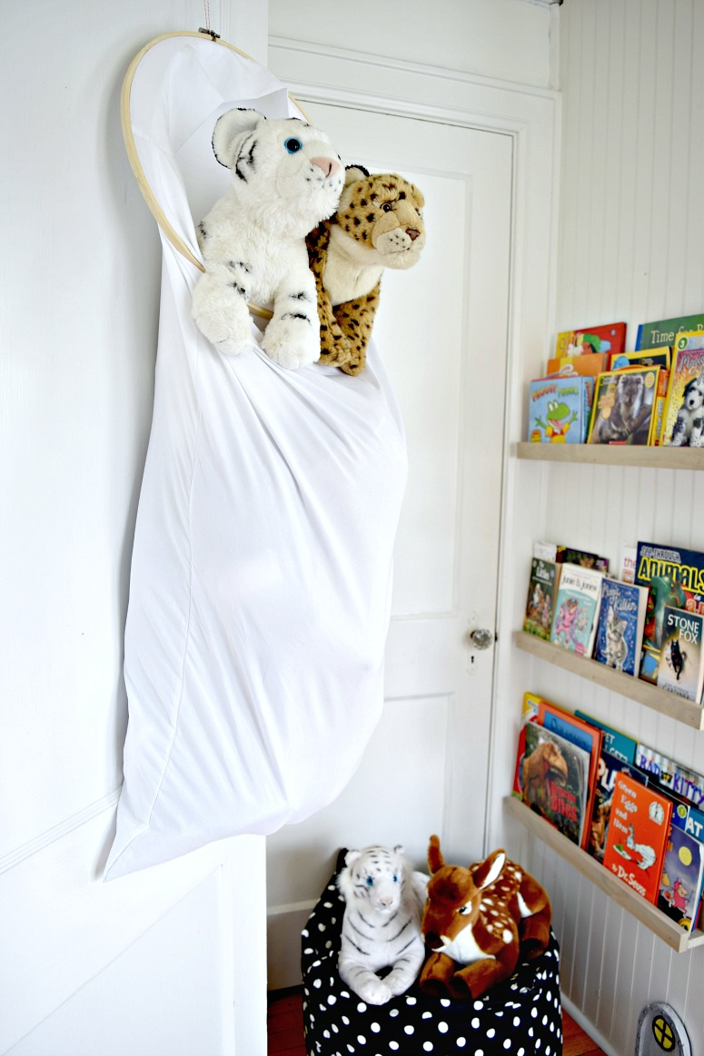 Use only 2 things and a piece of rope to solve your stuffed animal storage problems!