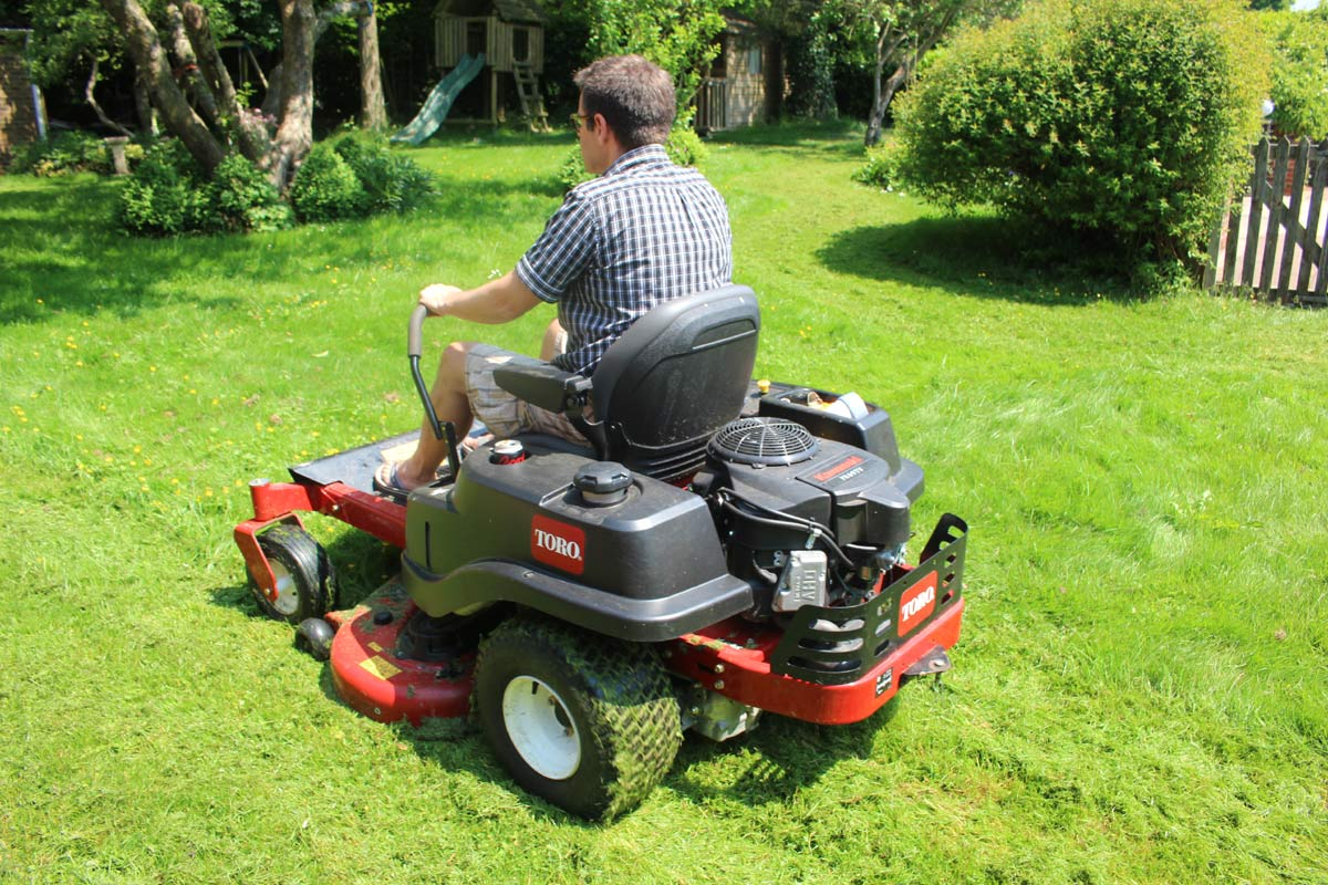 Ian mowing lawn on UK house sit