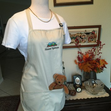 Beige apron on form with tshirt