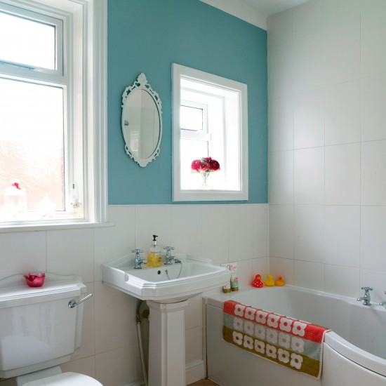 Compact bathroom with colourful feature wall | Small ... on Small Bathroom Ideas Uk id=94509