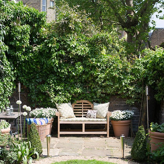 Country garden with outdoor seating and floral cushions ... on Country Patio Ideas id=57783