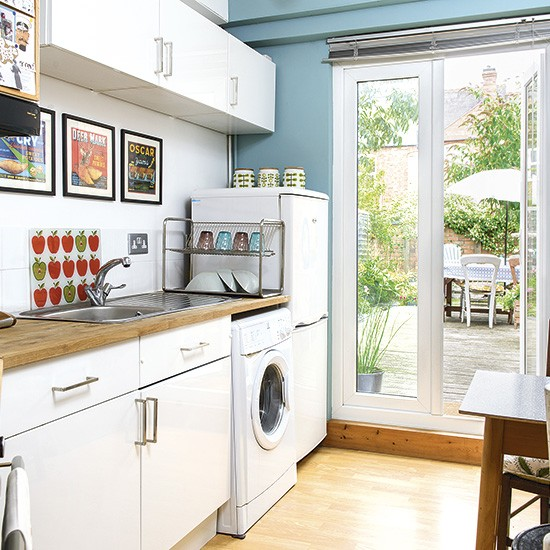 Traditional kitchen with white cabinetry and blue walls ... on Traditional Kitchen Wall Decor  id=62137