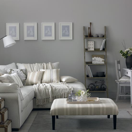 Grey living room with corner sofa and modern artwork ...