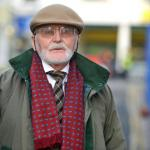 Image of John Hadman in a red scarf and hat