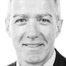 A black and white photo of John Doyle, CEO of social housing technology provider Voicescape.