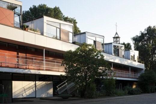 Interbau Berlin, Berlin, Germany. Architect: Various Architects, 1957. Paul Baumgarten Architects' 'Eternit haus' duplex apartments.