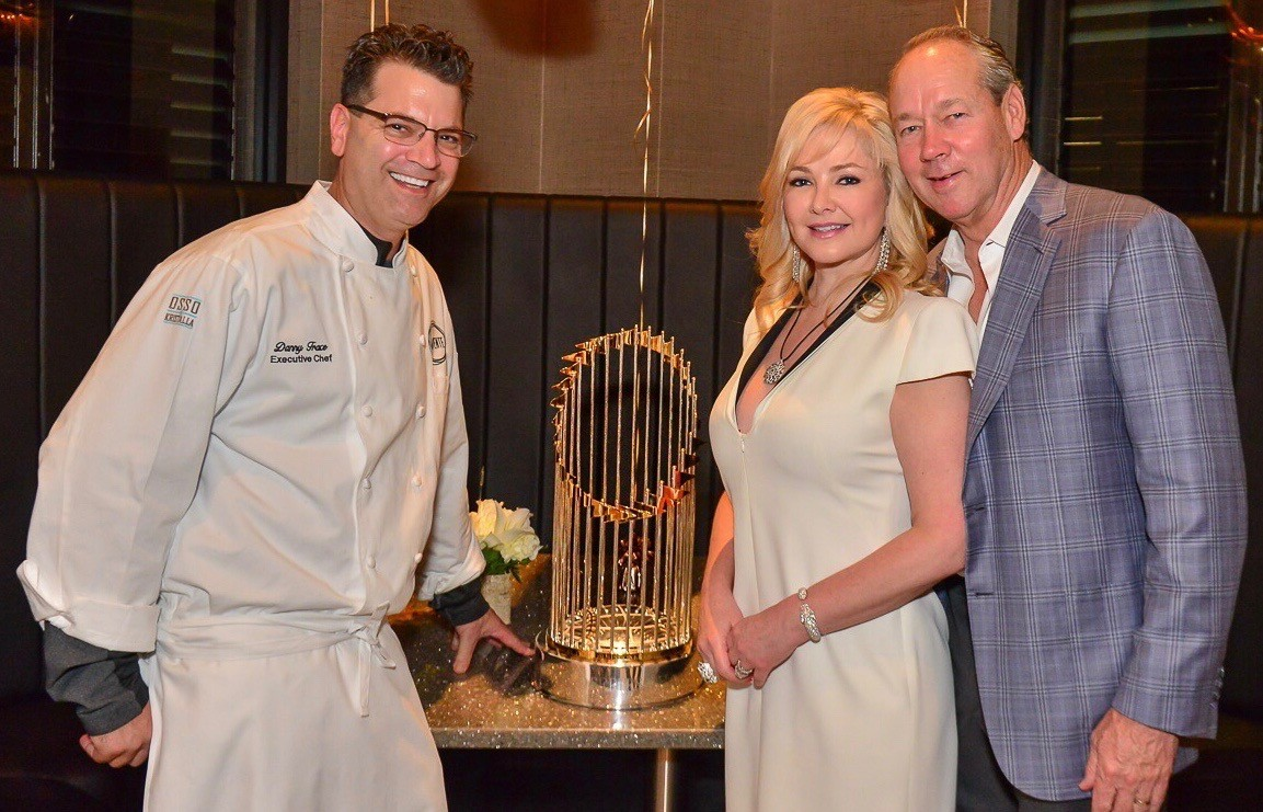Chef Danny Trace and Jim and Whitney Crane with World Series Trophy