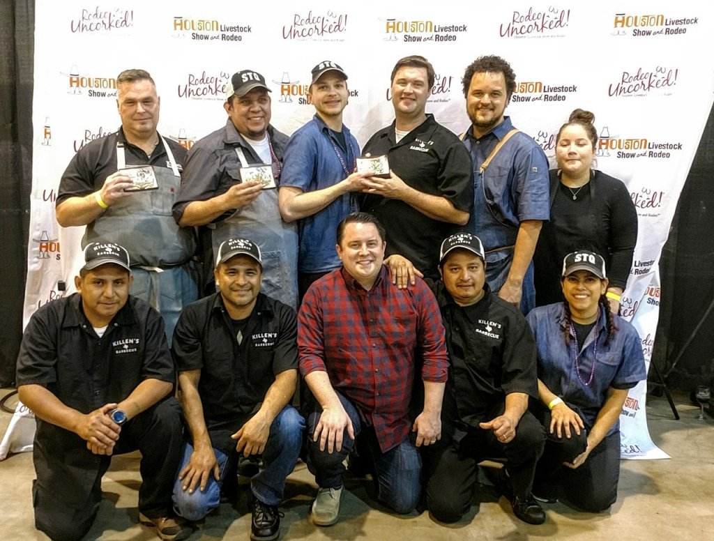 Big group photo of Ronnie Killen (back row, left) and his restaurant teams.
