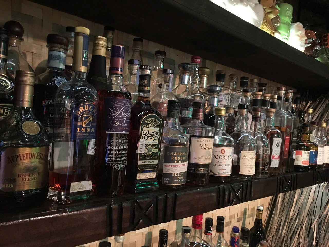 Picture of several rums on a shelf at Lei Low