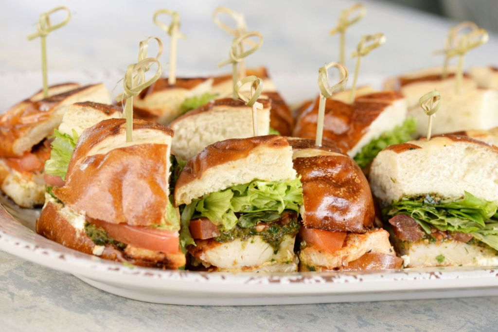 Picture of a platter of grilled pesto chicken sandwiches.