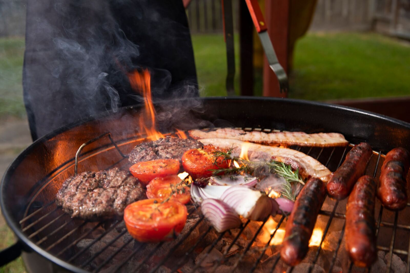 Image of meats on a grill.