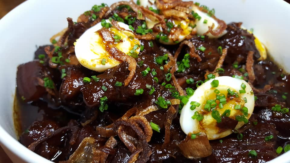 Shanghai style braised pork with quail eggs and crispy shallots at Decatur Bar and Pop-Up Factory