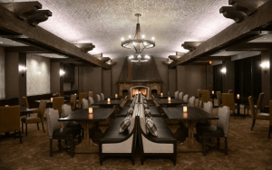 Spacious room with dark tables and luxe seating