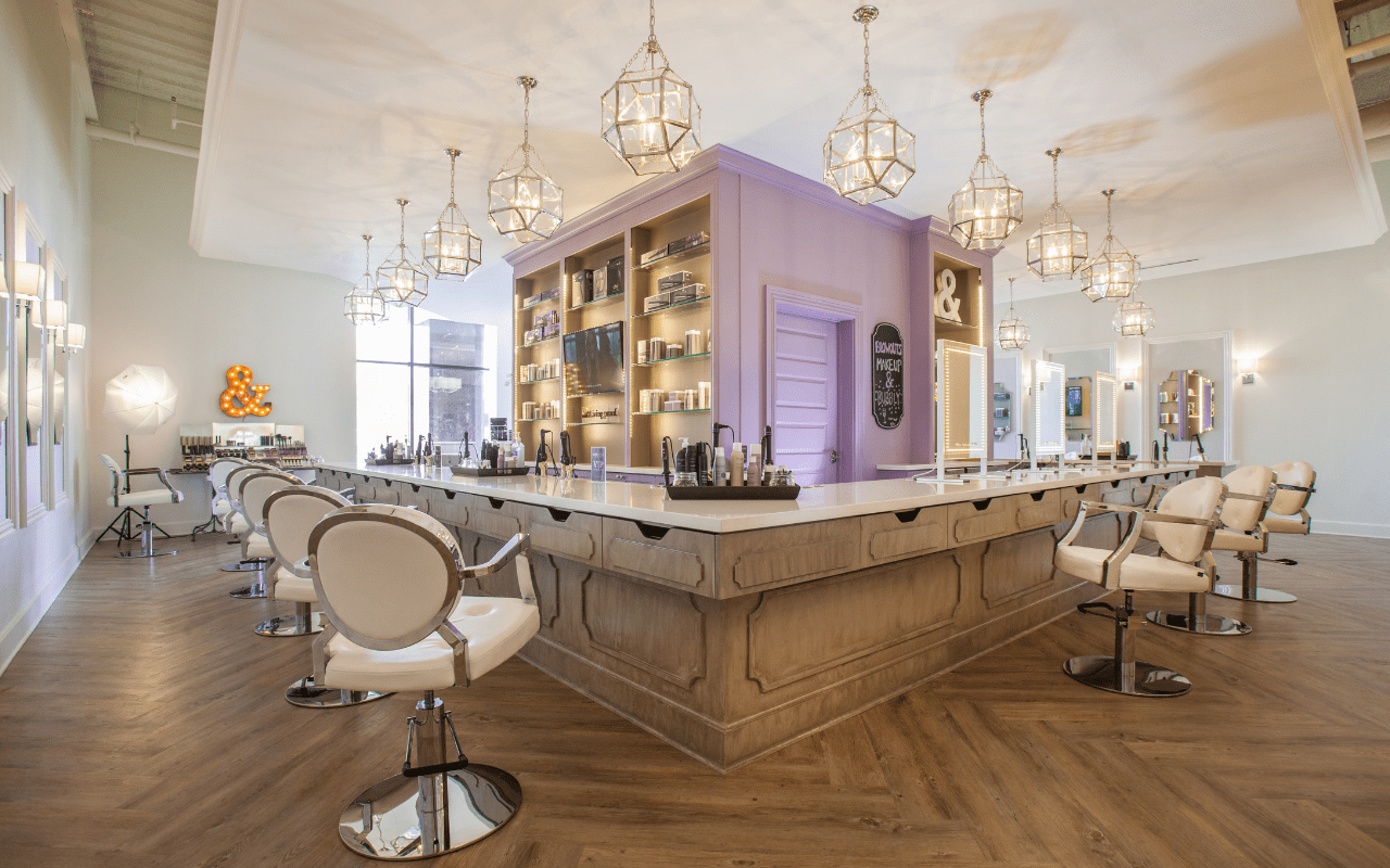 Luxe hair and makeup salon in shades of light brown, gold, cream and purple
