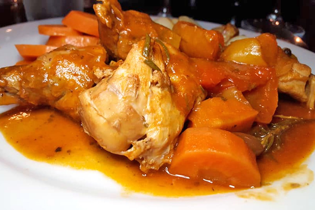 Coniglio in Umido, or stewed rabbit, roasted potatoes and carrots, at ROMA