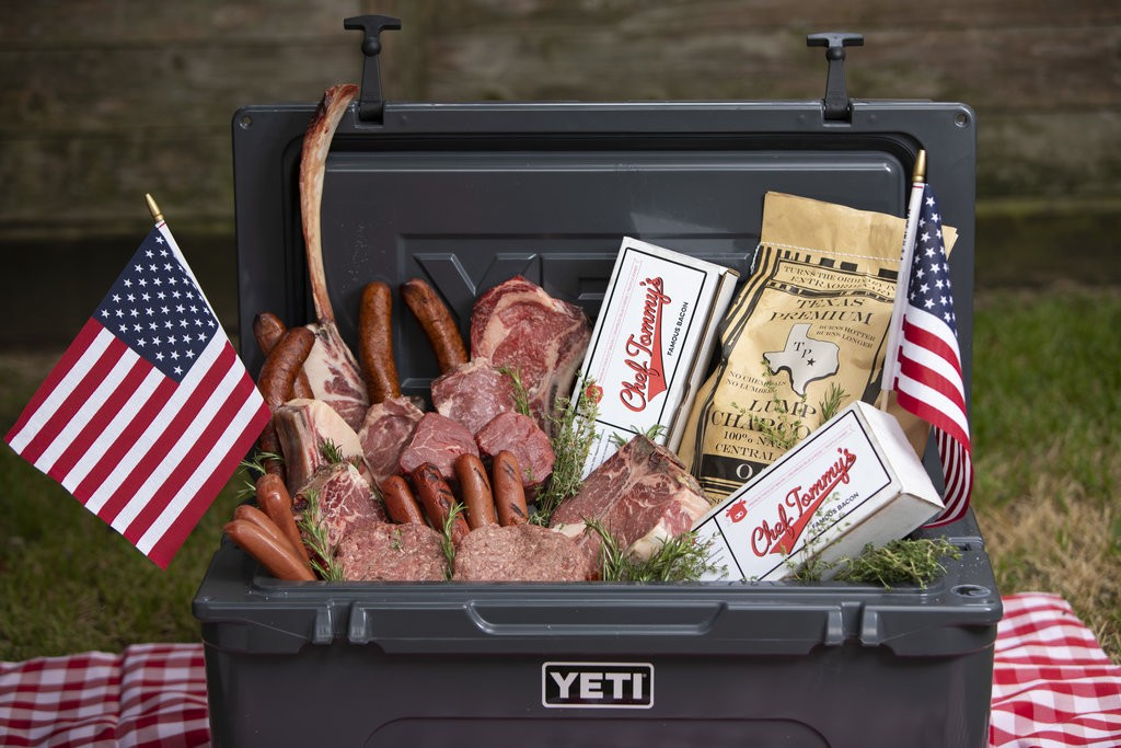 Photo of a Yeti cooler with several cuts of steaks and chops