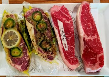 Marinated and plain steaks at Revival Market