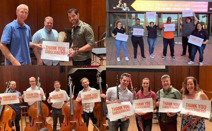 Houston Symphony musicians and patron services team holding signs that read,